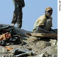 Miners handle stones on a hilltop of Mbola mines in Democratic Republic of Congo (File photo)