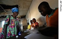 An election worker processes voters at a polling station in Bumba in Congo's Equatorial province, Sunday, Oct. 29, 2006