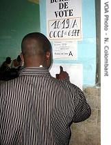 Man looks at preliminary election results