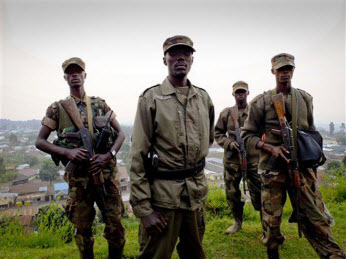 Colonel Sultani Makenga, center, a senior M23 leader, on a hill in eastern Congo, July 2012