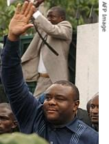 Jean-Pierre Bemba waves to a crowd gathered outside his house in Kinshasa