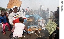 Opposition party supporters burn a poster of President Joseph Kabila during a rally at the city of Kinshasa, Tuesday
