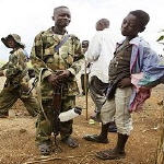 Child solders stand talking near the small village of Boga near Bunia, Democratic Republic of Congo