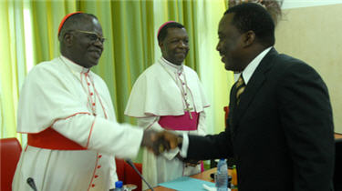 Cardinal Laurent Monsengwo Pasinya greets President Joseph Kabila on February 25, 2011