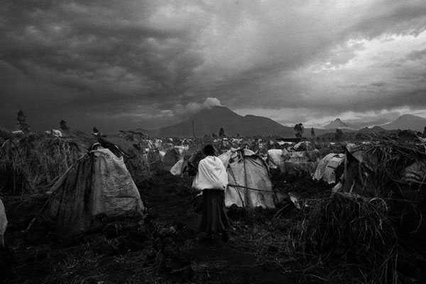 Forced to flee their homes in Karuba and Mushake because of fighting between government forces and Nkunda's troops, these displaced people seek shelter in a camp in Goma. © 2007 Marcus Bleasdale