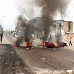 Protesters burn tires in Kinshasa