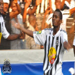 Mazembe's Deo Kanda celebrates with fans after scoring against Al Ahly