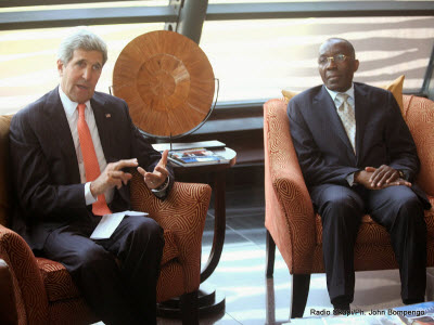 U.S. Secretary of State John Kerry (R) with Democratic Republic of Congo Foreign Minister Raymond Tshibanda in Kinshasa