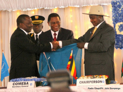 President Yoweri Museveni of Uganda hands over the chairmanship of COMESA to President Joseph Kabila of DR Congo