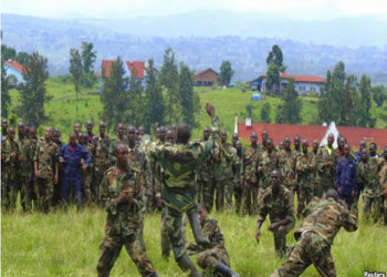 M23 soldiers demonstrate unarmed combat at Rumangabo military camp, North Kivu April 27, 2013