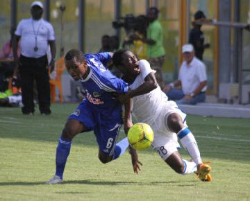 TP Mazembe's Deo Kanda play against Berekum Chelsea in the Champions League