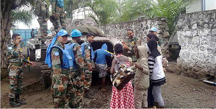 MONUSCO peacekeepers evacuate children following the capture of Goma in the DR Congo by M23