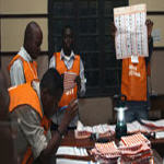 Elections officials counting votes