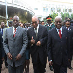DR Congo President Joseph Kabila (L) walks alongside South Africa President Jacob Zuma (C), and Mozambique President Armando Guebuza during a lunch break at the SADC summit in Maputo on June 15, 2013